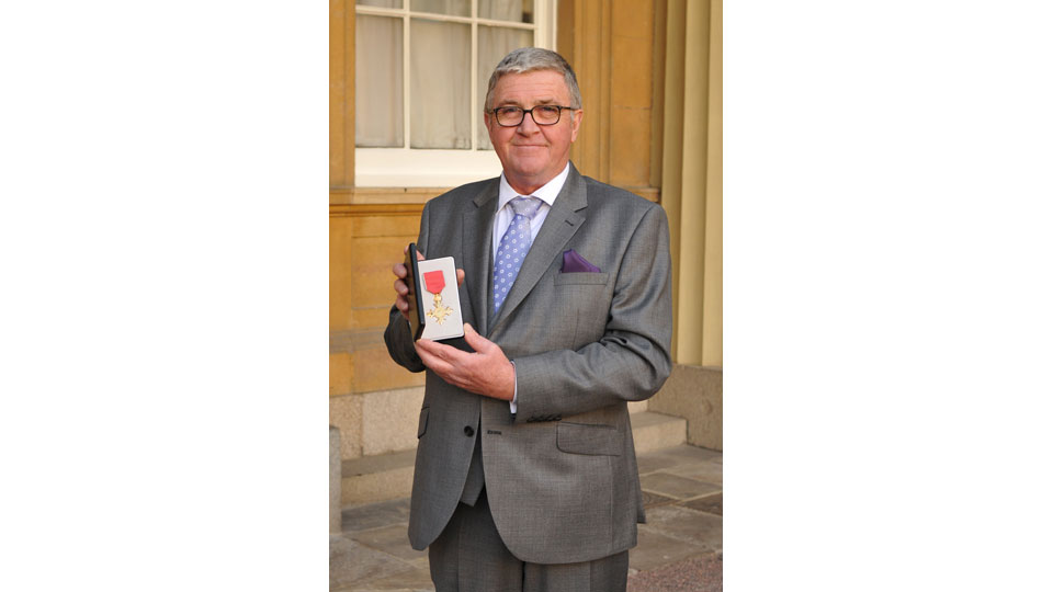 Brendan Joyce receives an OBE at Buckingham Palace